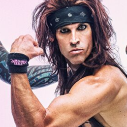 """Satchel"", the lead guitarist for Steel Panther - an American comedy glam metal band from Los Angeles, California."